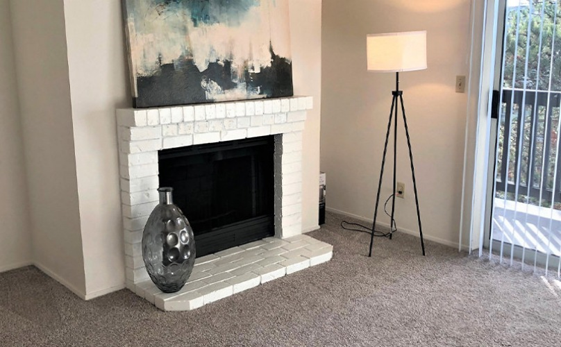 Living room with a brick fireplace